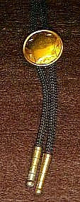Western bolo tie with star center.