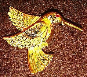 Gold tone hummingbird pin, rhinestone eye