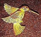 Gold tone hummingbird pin, rhinestone eye