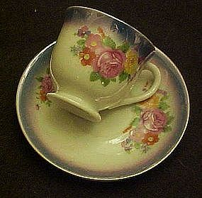 Occupied Japan lustre and roses demi cup and saucer