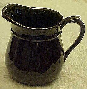 Old Vulcan Pottery pitcher. brown glaze