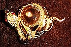 Vintage  coiled snake pin with rhinestones