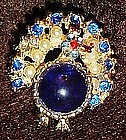 Vintage jelly belly  peacock pin, sapphire blue stones