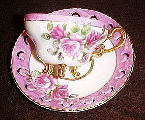 Fancy demitasse cup and saucer, lustre,three legs