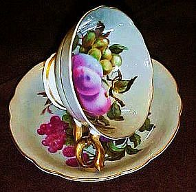 China cup and saucer set with hand painted fruit