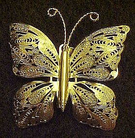 Goldtone butterfly pin with delicate filigree