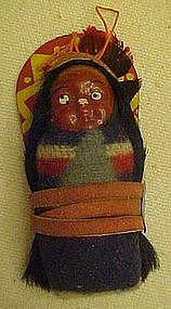 Vintage Skookum papoose on cradleboard, mailer