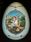 M.J. Hummel porcelain collector's egg, Apple tree girl