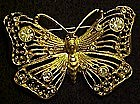 Gold filigree butterfly pin with rhinestone accents