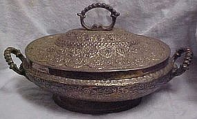 Old hand tooled  metal covered casserole dish