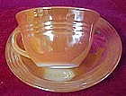 Fire king peach lustre, three bands cup and saucer