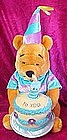Winnie the Pooh plush, with musical Happy Birthday cake