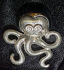 Two tone silver octopus pin, rhinestone eyes