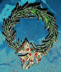Evergreen wreath pin with rhinestone bow