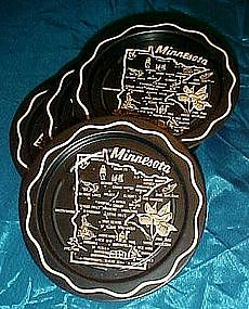 Set of four Minnesota souvenir coasters, black metal