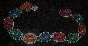 Multi color bracelet, oval scarabs, silvertone