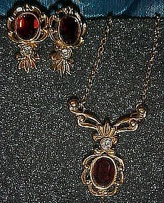 Juliette garnet necklace and matching earrings by Avon