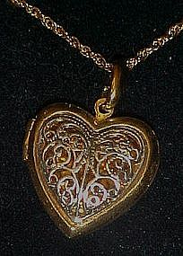 Two tone filigree heart locket , Avon