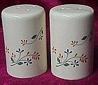 Tall glazed stoneware shakers, floral design