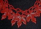 Vintage red plastic leaves necklace