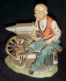 Hand painted bisque porcelain Blacksmith figurine