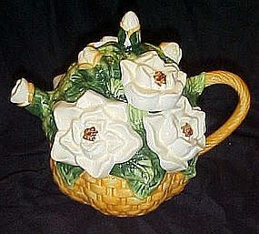Basket of white cammilia's or rose's, ceramic teapot
