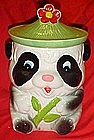 Older ceramic Panda cookie jar wearing green hat