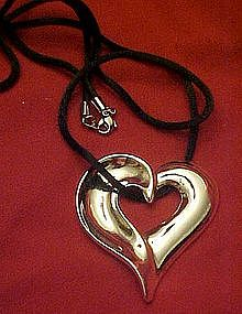 Avon silver  floating heart necklace,  silk cord