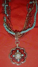 Avon six strand beaded necklace with medallion