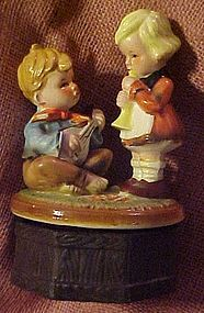 Older Hummel style  ceramic music box, boy and girl
