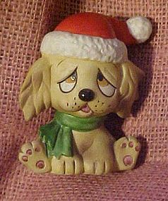 Porcelain puppy figurine in a Santa hat