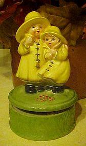 Vintage musical figurine, Children in rain coats
