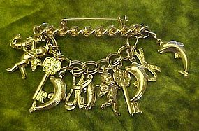 Gold tone links bar pin, angels, dolphins, key charms