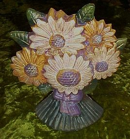 Bouquet of daisies cast iron door stop