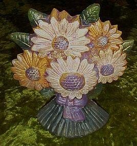 Bouquet of daisies cast iron door stop