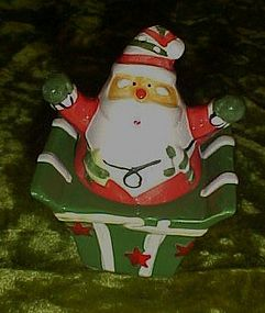 Santa jumping out of present salt and pepper shakers
