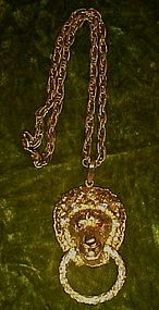 Great chunky gold tone Lion doorknocker pendant