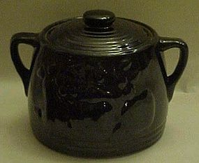 Old black glaze bean pot with fruit