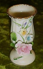 Vintage porcelain miniature vase with applied roses