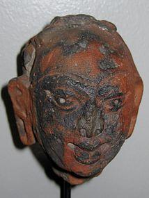 GANDHARAN TERRACOTTA BUDDHA HEAD