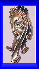 Portrait of a woman  sterling brooch unsigned 1942