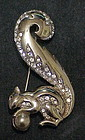 Boucher squirrel holding a pearl brooch-1948