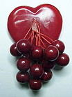 Bakelite heart pin with 12 berries