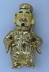 """Napier """"Ming""""  man holding his belly brooch"""