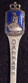 Sterling souvenir spoon: Danmak nude on rock-Enamel