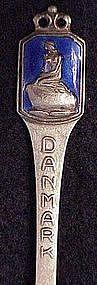 Sterling souvenir spoon: Danmak nude on rock-Enamel