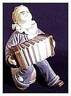 Royal Copenhagen porcelain child with accordion # 3667