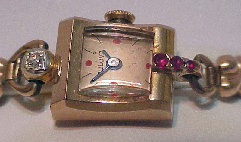 14K rose gold diamond & rubies Bulova Lady's wristwatch