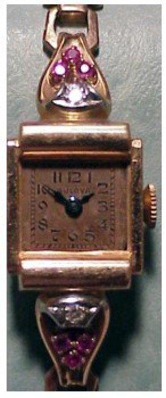 14K rose gold Bulova diamond & ruby lady's watch
