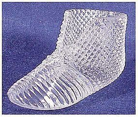 Circa 1900 ribbed glass bootee with a diamond pattern